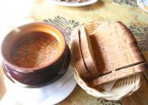 Hot borsh soup is traditionally served in pots with black bread