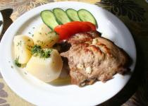 Fried beef with boiled potatoes and fresh vegetables